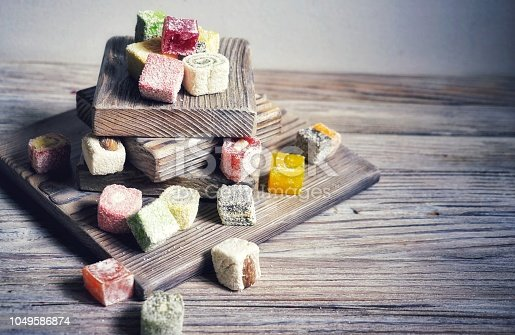 Turkish delight on white rustic background. Turkish deligh set. Assorted traditional turkish delight on oriental background.