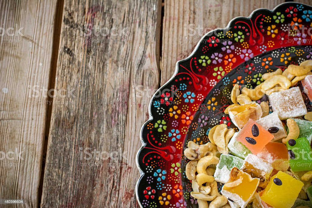 Turkish delight with colorful chocolate seeds and cashew nuts stock photo