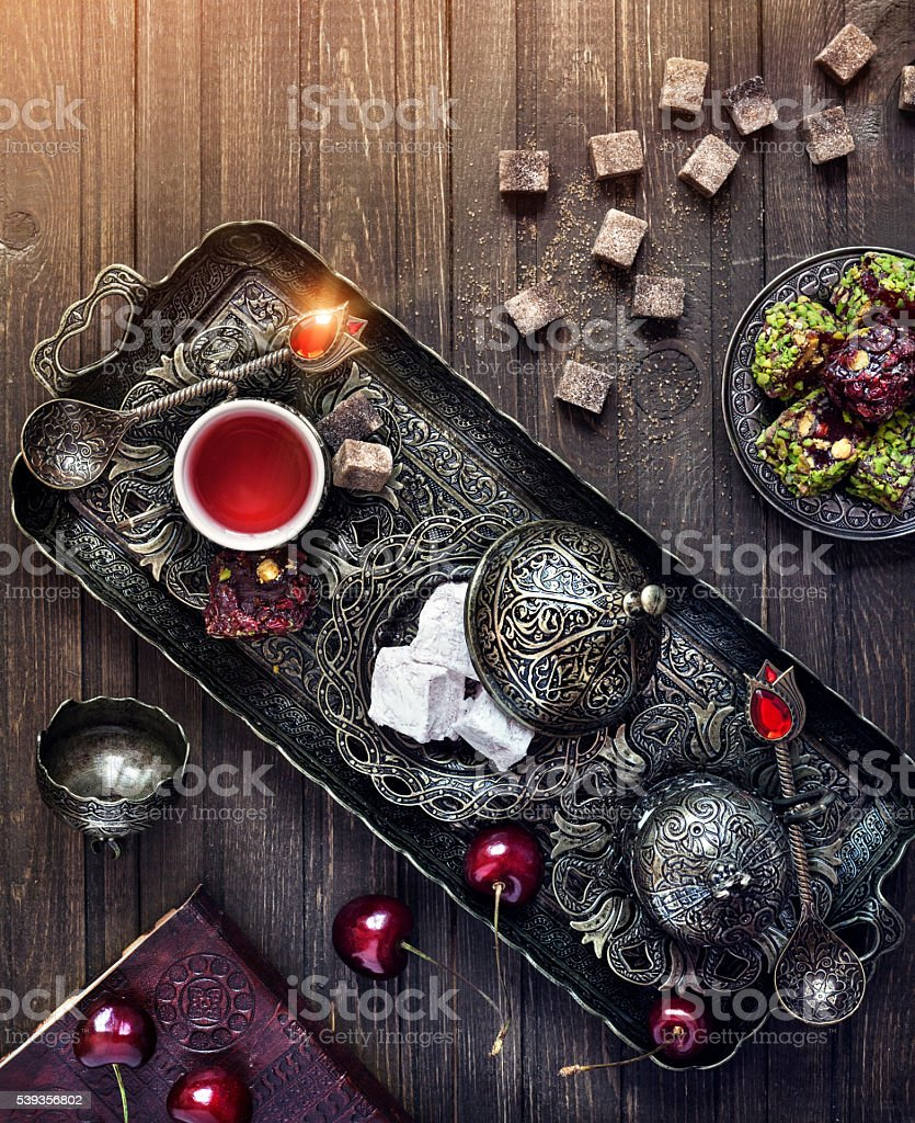 Turkish delights and tea on the table in Istanbul stock photo