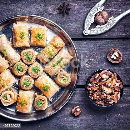 istock Turkish delights baklava on wooden table 497352022