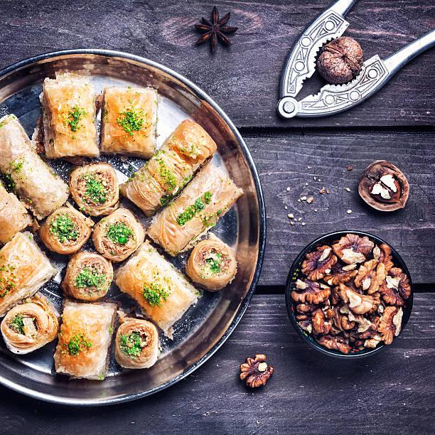 Turkish delights baklava on wooden table stock photo
