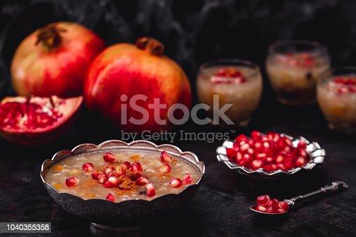 618202484 istock photo Turkish Dessert Ashura With Pomegranate, Noah's Pudding 1040355358
