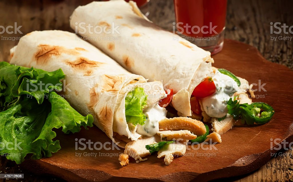 Turkish doner kebab, shawarma, roll with meat and pita bread stock photo