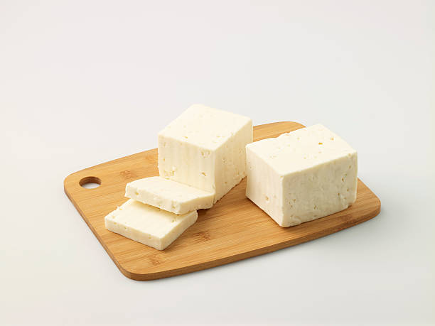 Turkish Feta Cheese On Chopping Board Turkish Feta Cheese On Chopping BoardPlease see some similar mobile pictures from my portfolio: feta cheese stock pictures, royalty-free photos & images