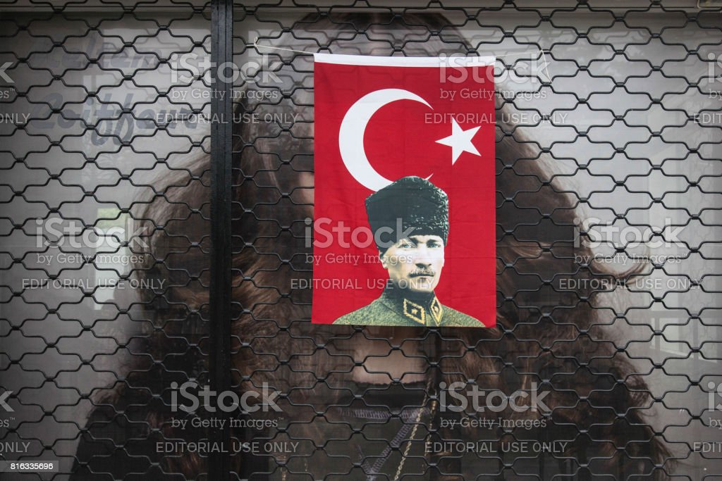 Turkish flag and Attaturk in hairdresser window stock photo