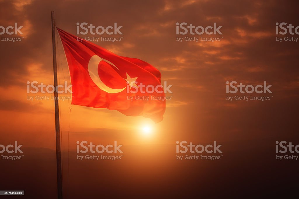 Turkish flag flies over the sun in Turkey. stock photo