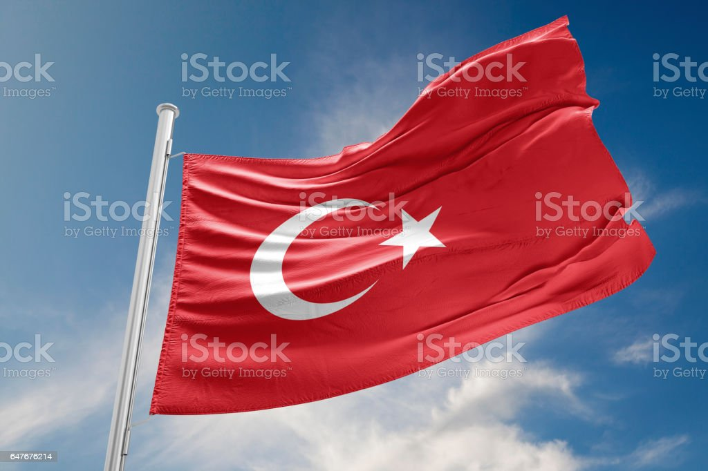 Turkish Flag is Waving Against Blue Sky stock photo