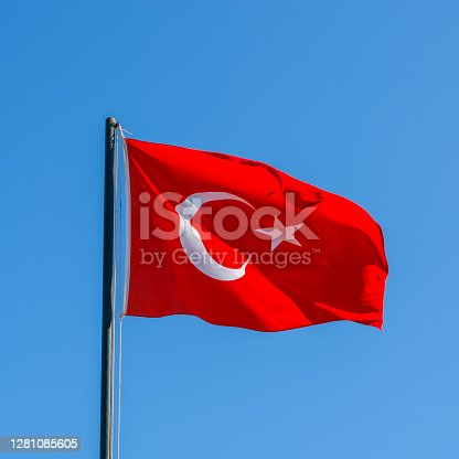 Turkish flag. national flag of Turkey. Flag of Turkey rise waving to the wind with sky in the background. concept of tourism and politics, close up.