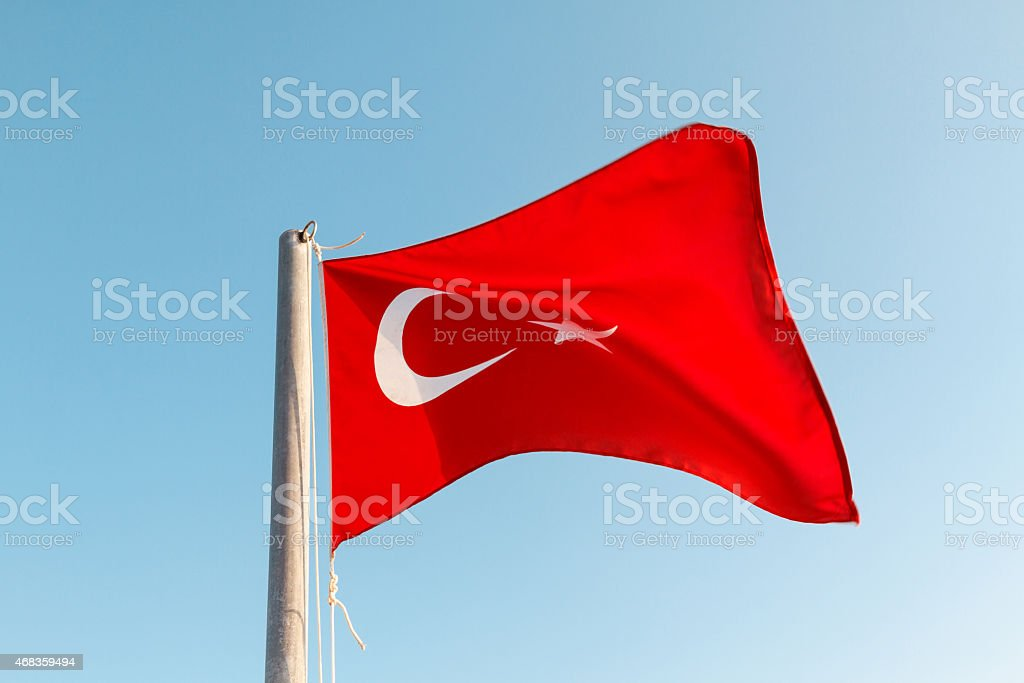 Turkish flag waving against a blue sky royalty-free stock photo
