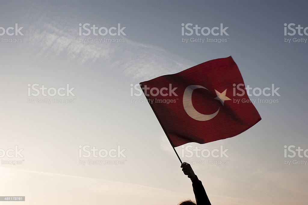 Turkish flag waving through sky stock photo