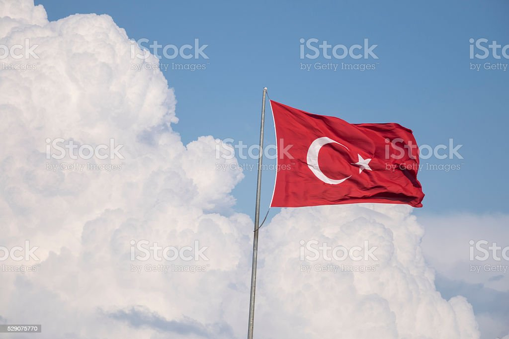 Turkish Flag Whips On Cloudy Sky stock photo