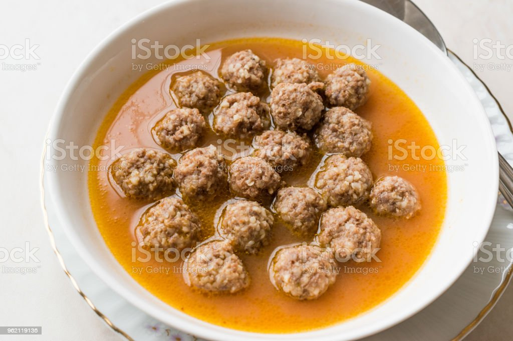 Turkish food Sulu Kofte / Juicy Meatballs Soup with Bread. stock photo