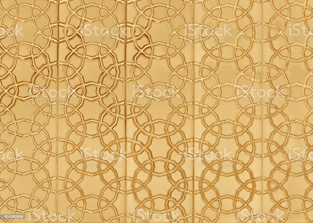 Turkish gold ornament on the wall of the mosque stock photo