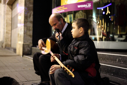 istock Turkish Grand Father and Son playing Music for donations, Istanbul 458572275