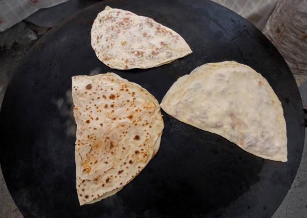 turkish gözleme on the on sheet iron (turkish sac) ,closeup, Tu stock photo