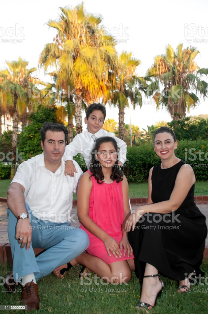 Turkish Happy Mother And Father Enjoying Their Children