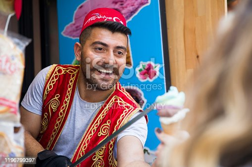 Unidentified seller of Turkish ice cream at Istanbul, Turkey. Traditional Turkish ice cream was made with salep, produced by orchid flowers.