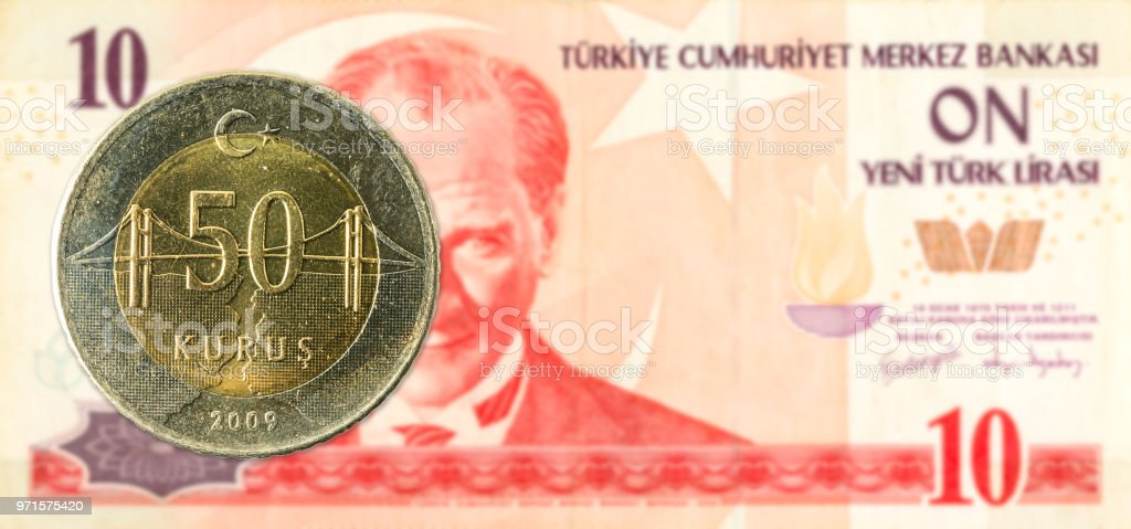 50 turkish kurus coin against 10 turkish lira banknote stock photo
