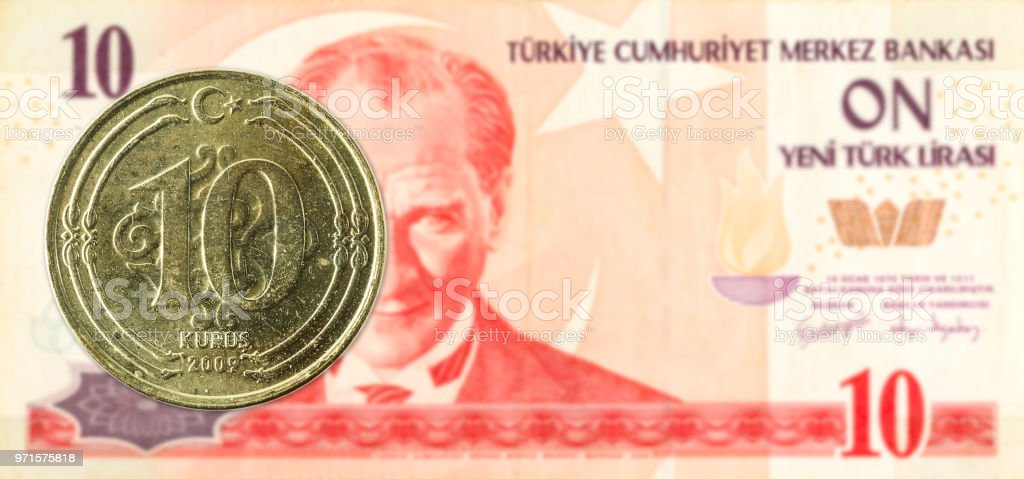 10 turkish kurus coin against 10 turkish lira banknote stock photo