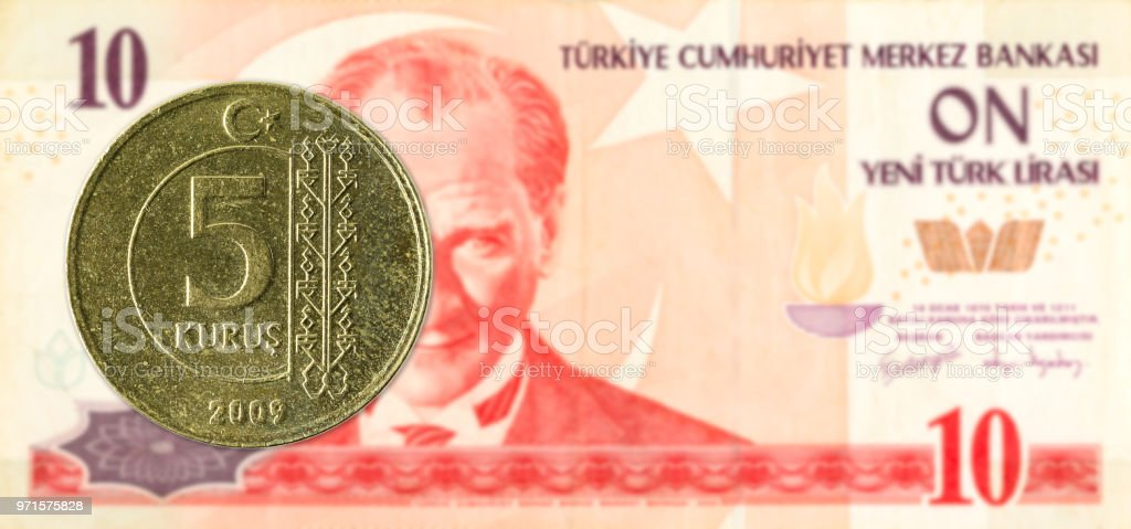 5 turkish kurus coin against 10 turkish lira banknote stock photo