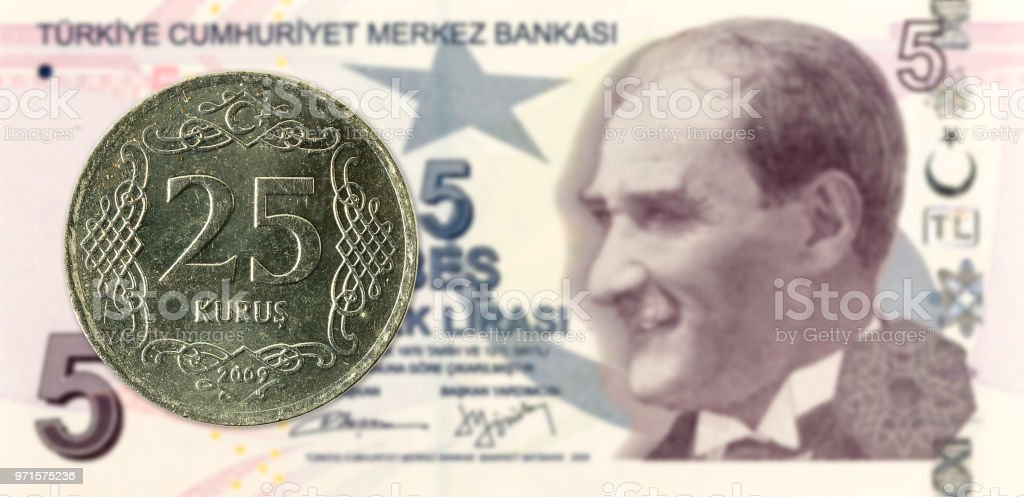 25 turkish kurus coin against 5 turkish lira banknote stock photo