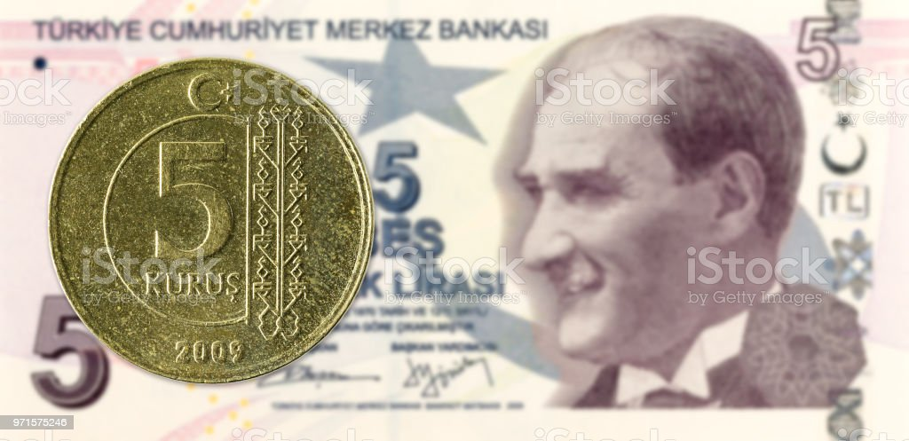 5 turkish kurus coin against 5 turkish lira banknote stock photo