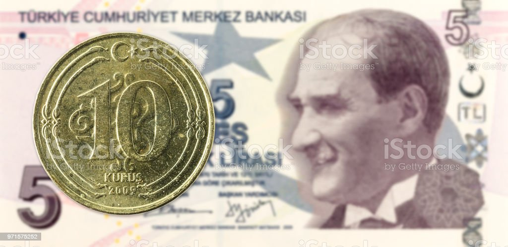 10 turkish kurus coin against 5 turkish lira banknote stock photo