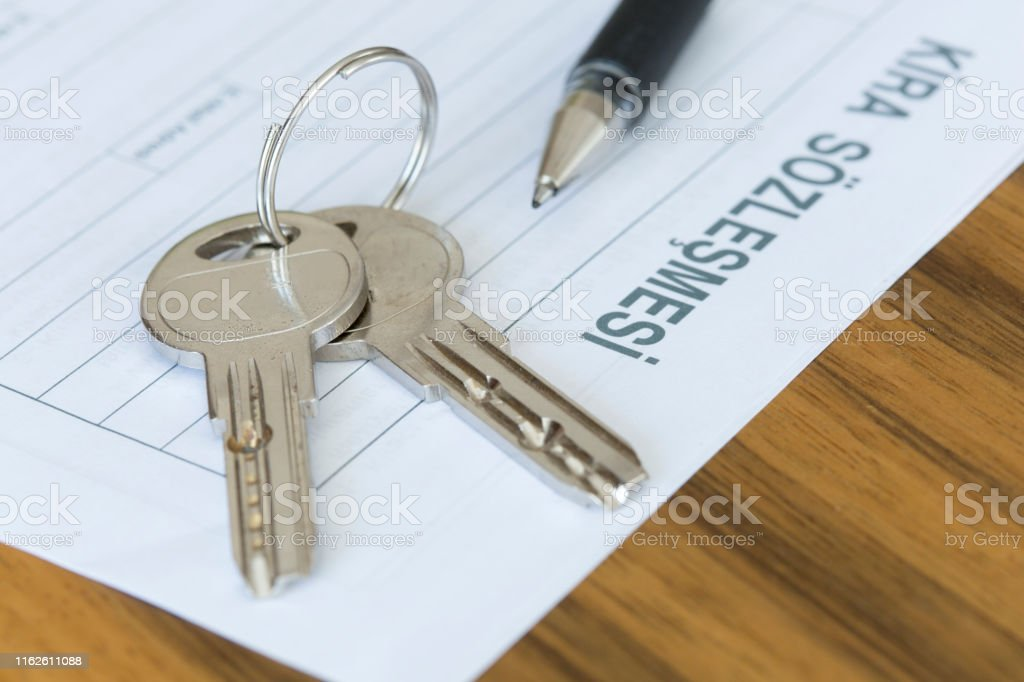 Turkish lease agreement form with pen and keys on it. Rental...