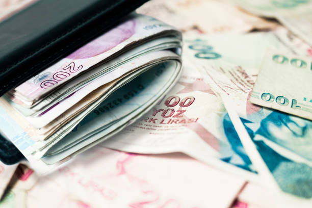 Turkish lira banknote in wallet and banknote background stock photo