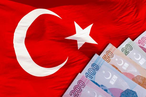 Turkish Lira banknotes and Turkish flag stock photo