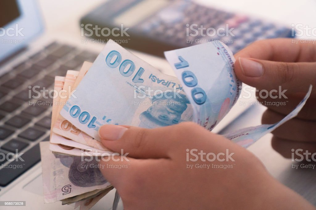Turkish Lira Count Computer And Calculator Unknown Person Stock