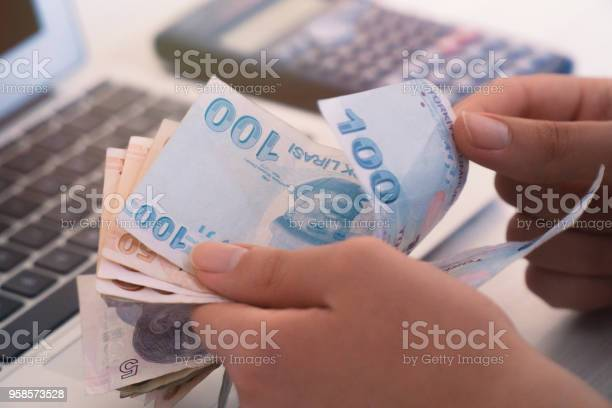 Photo of turkish lira count, computer and calculator unknown person