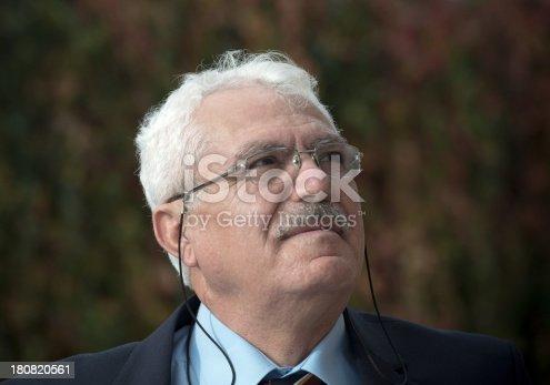 Turkish business man portrait, looking up.