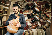 Turkish Man Playing Clay Darbuka