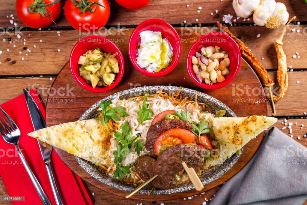 Turkish meatball with sauce, bread and salad stock photo