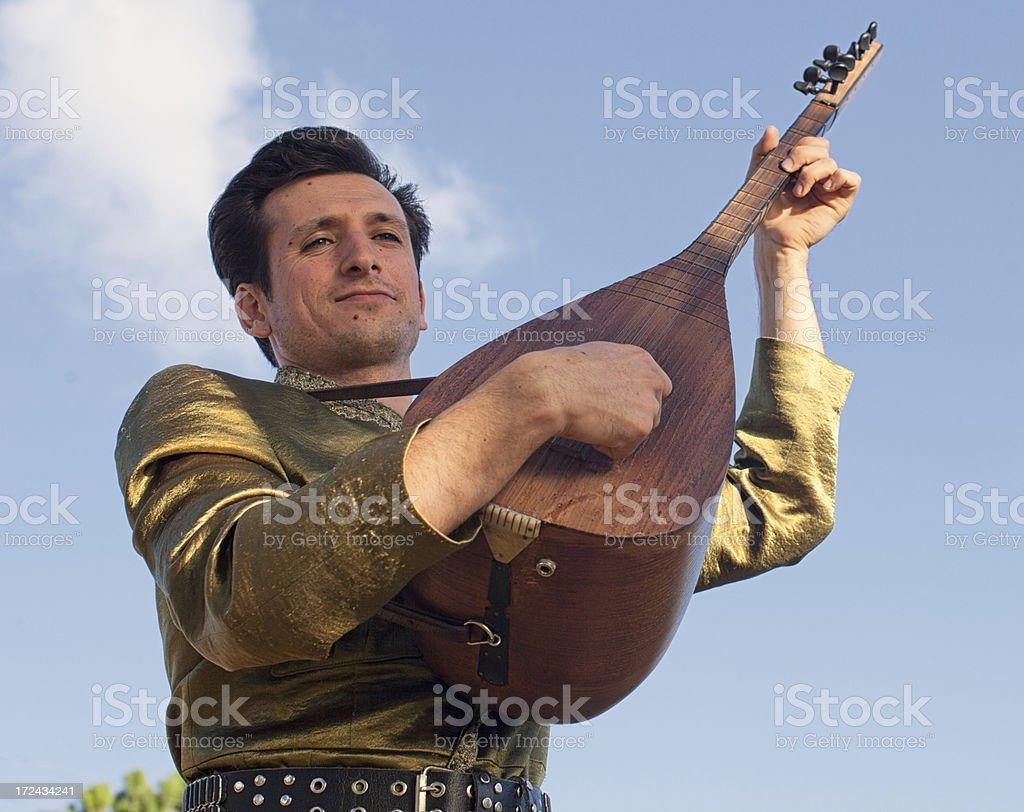 Turkish Musician playing instrument royalty-free stock photo