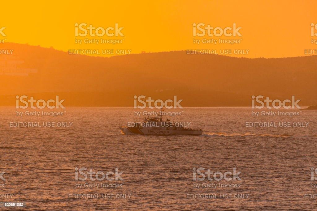 turkish navy military coast guard boat during sunset at gulluk bodrum mugla turkey stock photo
