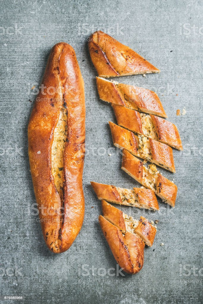 Turkish oriental pizza pide with cheese and spinach, grey background royalty-free stock photo