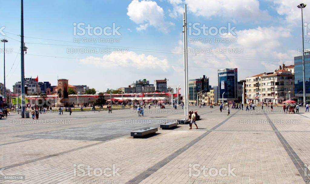 Turkish people walk at Taksim Square in Istanbul stock photo