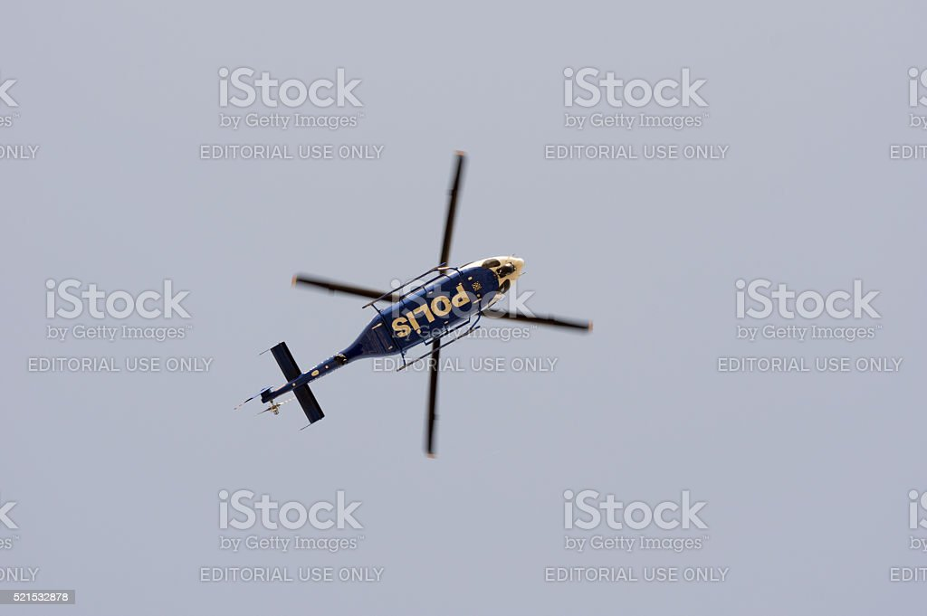 Turkish Police Helicopter Flying Over The City Stock Photo