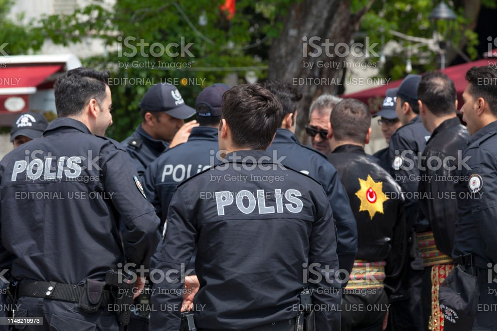 Turkish policemen Istanbul, Turkey - May 09 2019: Group of policemen (Polis) discussing the street. Adult Stock Photo