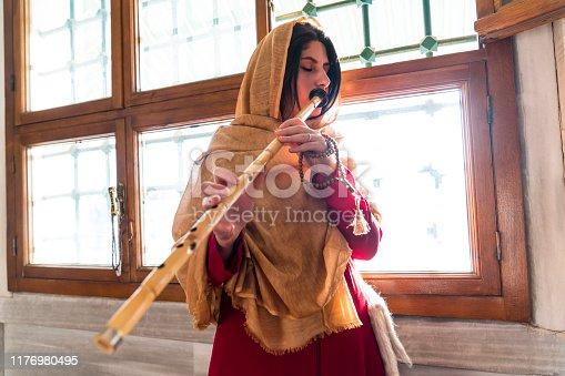 Turkish reed flute artist. sufi muslim woman in mosque