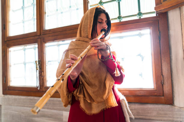Turkish reed flute artist. sufi muslim woman in mosque stock photo