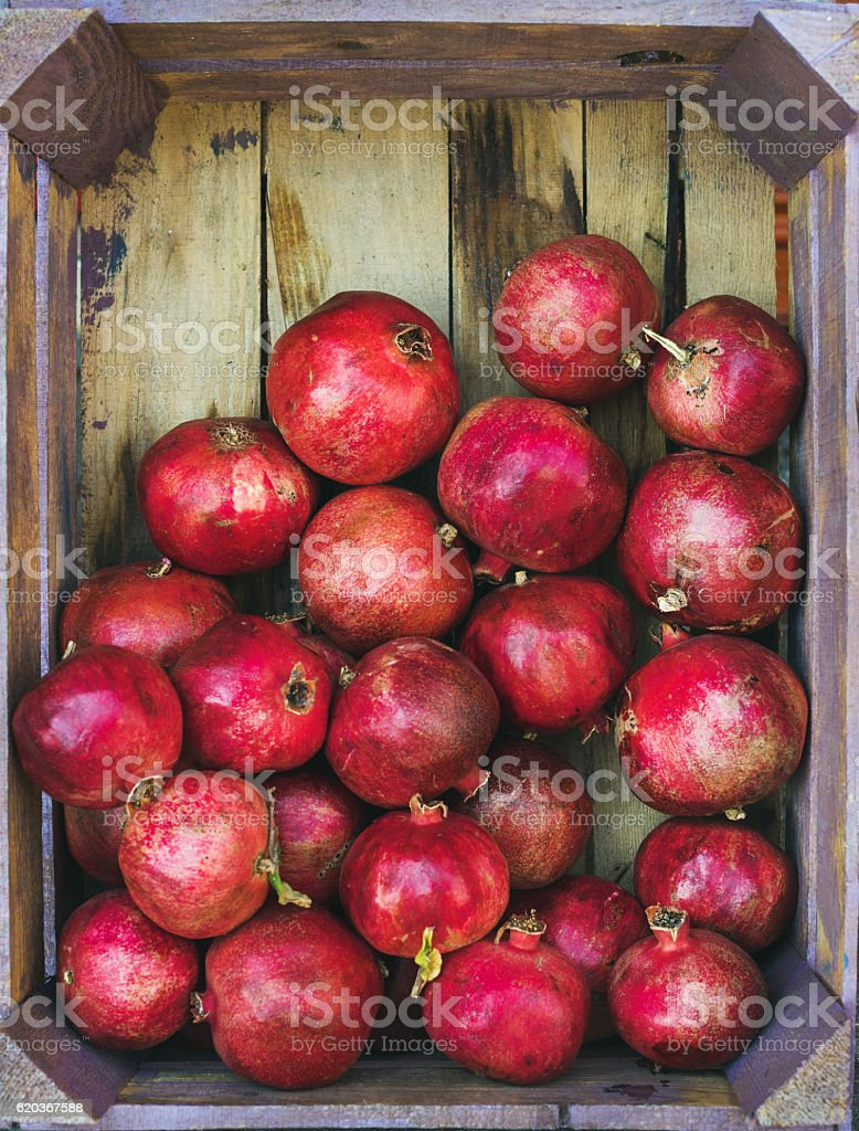 Turkish ripe pomegranates in wooden box, copy space foto de stock royalty-free