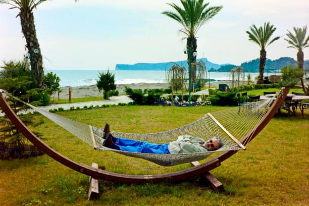 Turkish Riviera – A tourist relax in the garden of a resort nearby Kemer, Turkey. stock photo