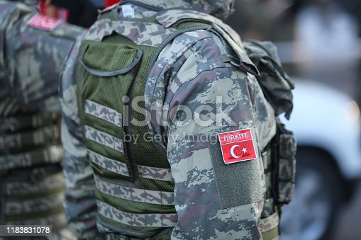 Turkish soldiers, holding MPT 76 assault rifles (7.62x51 mm NATO), take part at the Romanian National Day military parade