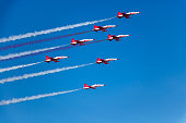 A group of seven airplanes gives the audience an exciting show.