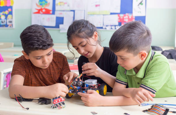 turkish student group are developing the robot in the classrom turkish student group are developing the robot in the classrom turkey middle east stock pictures, royalty-free photos & images