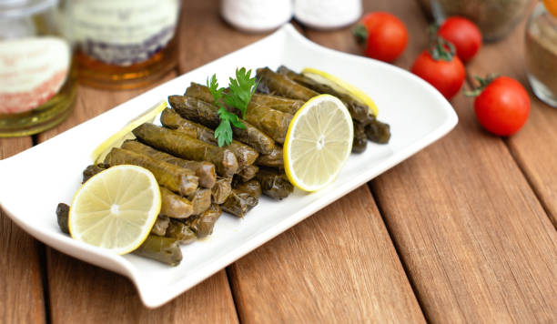turkish stuffed grape leaves in white plate stock photo