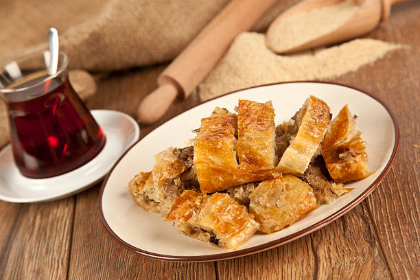 Turkish style meat stuffed filo dough borek served kol boregi picture id499124765?b=1&k=6&m=499124765&s=612x612&w=0&h=dzr8zoveqaccpyjcjwfhyzvknmlkpfkux4av7uv8yqo=